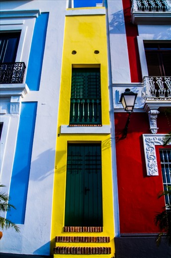 This is the smallest building of the world located at San Juan, Puerto Rico. It's quite colorful and cheerful, but the fun thing about it is that people actually live there and when the doors are open you can see the entire inside of the building.