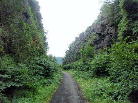Bike path through old railroad cut at Little Falls, NY.  The railroad failed so the cut was never used.
