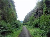 Bike path through old railroad cut at Little Falls, NY.  The railroad failed so the cut was never used.: by johnkeith, Views[275]