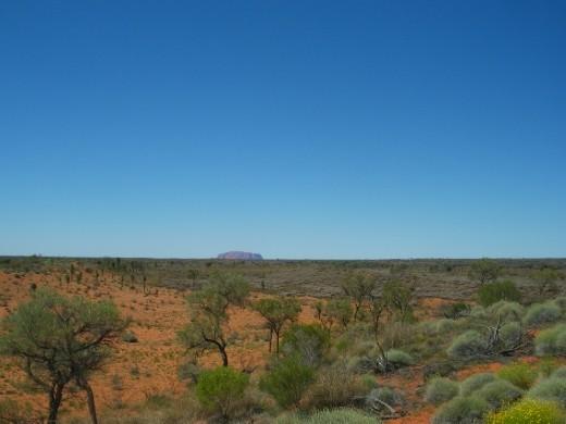 Uluru in distance.