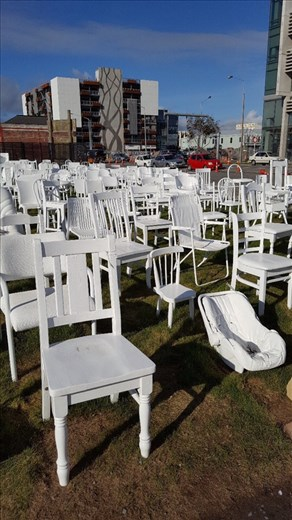 185 white chairs represent lives lost in earthquake