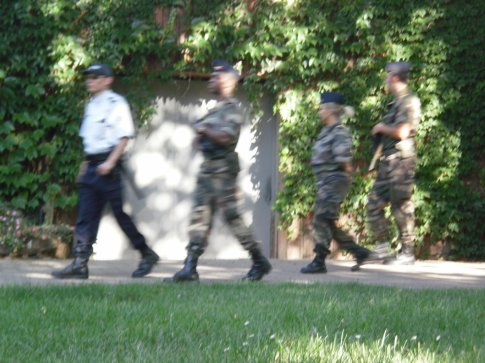 again, militry walking around with automatic guns
