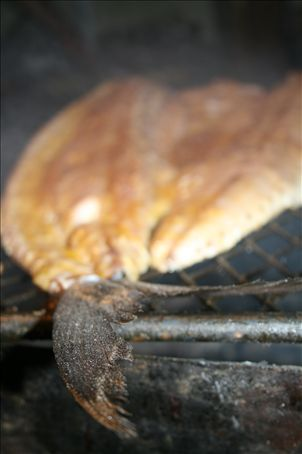 snoek - marinated in oil, butter, apricot jam and garlic sizzles away.