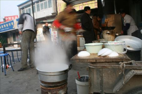 Huntun is popped into boiling stock as it is ordered.  Other pots on the go are bean curd and deepfried cake units.