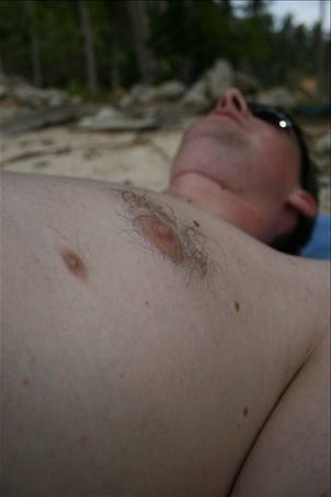 I took this photo of Geoff (a Canadian pilot)on an isolated beach on Koh Pi Pi.  Can you spot his 3rd nipple?  How fitting for an island area used for a Bond Movie.