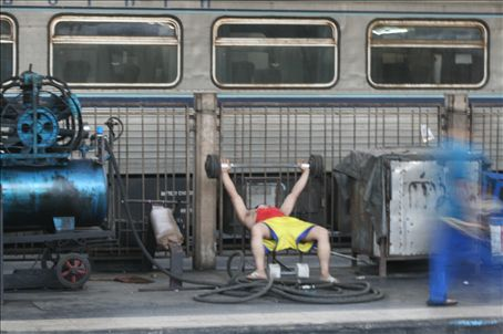 Man works out at Bankok train station