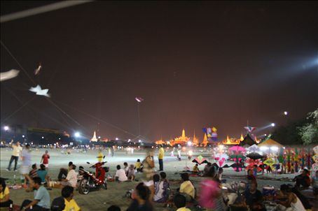 March is kite flying season and kids go to the park near the Grand Palace to have kite fights