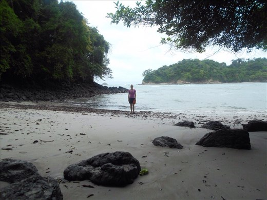 Juanita trying to find a spot to swim on the beach, too many rocks there.