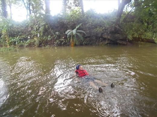Jorje having a dip off the raft.