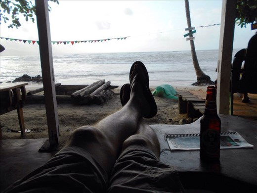 Perfect location on the beach for a bar. Jorje enjoying happy hour.