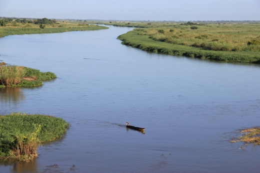 Zambezi river. A canoe and a crocodile (?). - Mozambique ...