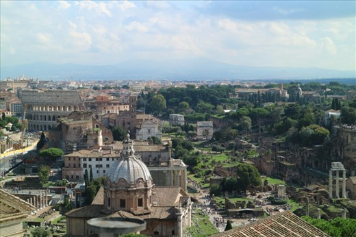 View of the Colosseum and the Roman Forum from the top of the Vittorio Emanuelle monument