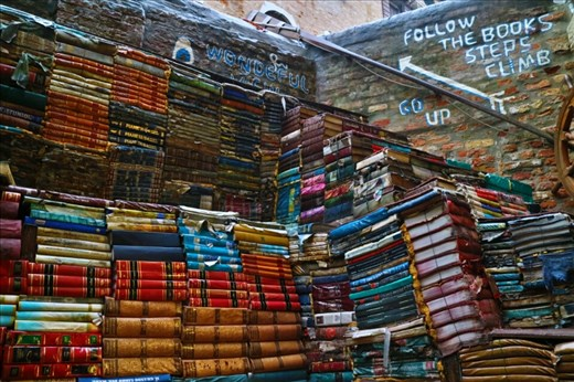 Agua Alta, a quirky book store that used books damaged in a flood to build a staircase to a viewpoint