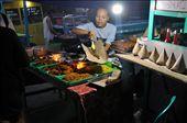A woman serves up fish and noodles at the Gili Trawangan night market: by josheastwood, Views[563]