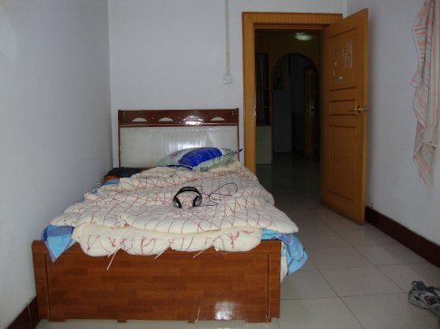 A shot of my bed in my apartment in Shiyan.