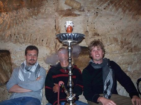 Enjoying a sheesha with traveling pals in a 2000 year-old Nabataean cave