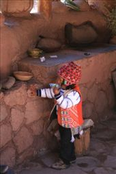Child in traditional clothing in the Urubamba Valley, drinking from a juice box.: by jshechtman, Views[198]