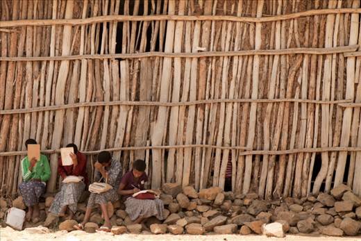 Girls are preparing homework for the next class.