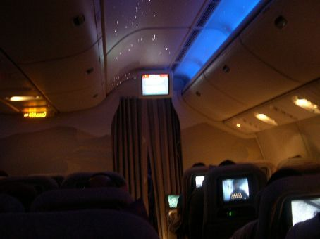 Interior of a Boeing 777 with the cabin lights off. You'll notice feint lights in the ceiling to resemble actual star constellations