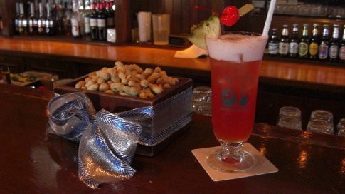 Singapore Sling in Raffles.  It's traditional to throw the peanut shells on the floor of the bar.....you do it outside you get a $500 fine!!!
