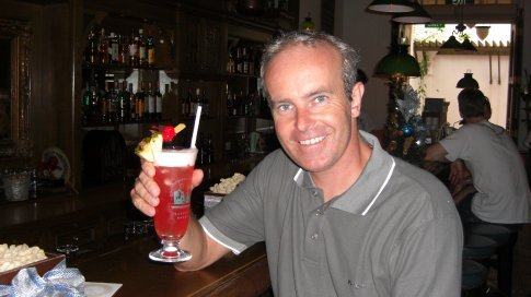 Having a Singapore Sling in the famous Long Bar at the Raffles Hotel, where the famous cocktail was born.