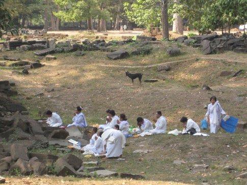 Buddhist nuns praying outside of Bayon temple