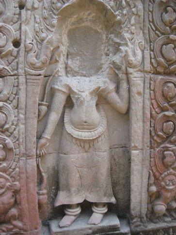 sadly defaced sculpture at Angkor Wat