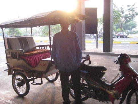 Goodbye Mr. Sary, goodbye Cambodia, sunrise drop-off at Siem Reap airport.