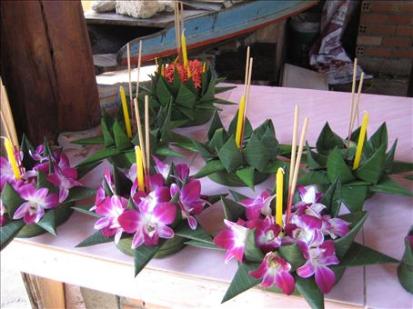 Krathongs, made to float on the river with candle and incense lit.