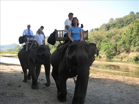 Elephant riding on my 33rd birthday, with Meixi the elephant and Joe the Democrat from Texas