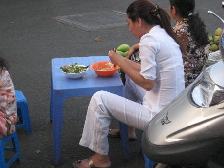 Streetside elegance with bowl of pho, Saigon
