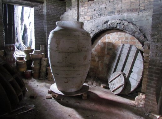 the entrance to the kiln and a large pot mould