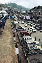 At Darjeeling, a city hanging off a cliff in the nothern area of West Bengal, the most practical way to move around is by Jeep. Here a young boy calmly oversees the frantic activity going on in the main jeep stop, as people look for rides.: by kainet, Views[410]