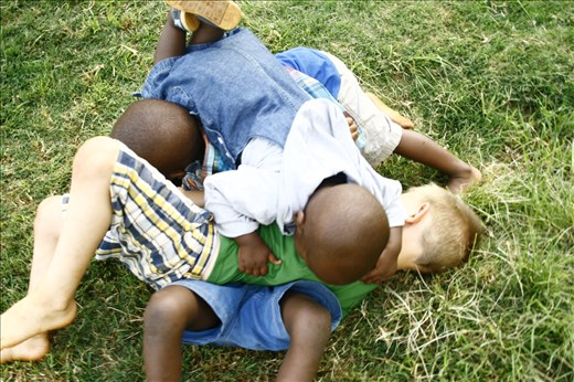 Brotherly wrestling quickly become a dog pile for all the boys.