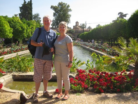 Paul & Kathryn in the gardens of the Alkazbar in the footsteps of King Ferdinand and Queen Isabella.