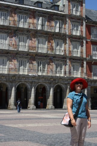 Kathryn in Plaza Mayor. The red hat has travelled Europe with me.