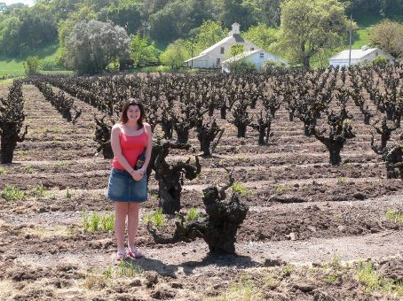 Helen with the vines where the wine in her hand came from - St Francis Zinfandel