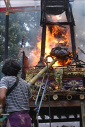 The body falls through the bottom of the cremation