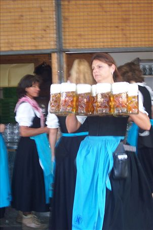 a Lowenbrau fraulein carrying an incredible number of steins!