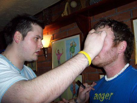 James putting mascara on Tom