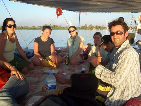 playing cards at sunset on the felucca