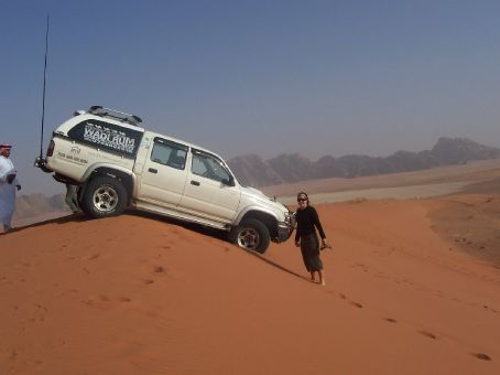 our car poised at the edge of a dune