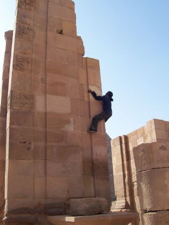 Achmed our (monkey) guide scaling a wall