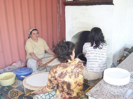 women making pancakes in the village