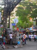 The corner of De Tham and Bui Vien, with sstreet vendor and crazy electric cables.: by keishia, Views[213]