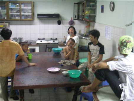 The kitchen with Miss Lop and Kiet centre. The boy to the left (cant remember his name) is always singing really loudly but is kinda shy and will never speak to me!