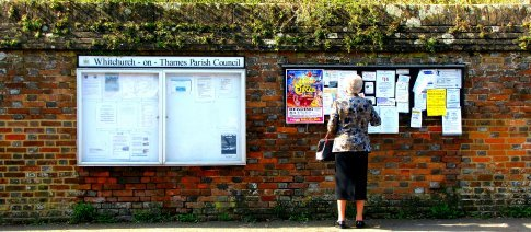 Miss Marple looks for clues on the community noticeboard opposite The Greyhound pub in Whitchurch