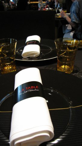 Black and gold are the table motifs...
