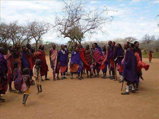 original Masai family dancing traditionally
