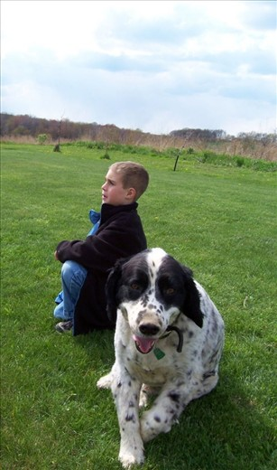 Nicholas, the eldest son in my host family, waited anxiously for his turn to bat in a mini baseball game with his cousins. Meanwhile, a sheep dog had enough of watching his human friend and decided to smell the photographer instead. West Sunbury, Pennsylvania, USA.